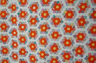 This lively cotton 30s grandmothers flower garden quilt is hand