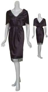 Sophisticated silk cocktail dress. Draped neckline is pleated at the