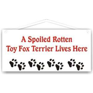 A Spoiled Rotten Toy Fox Terrier Lives Here Everything Else