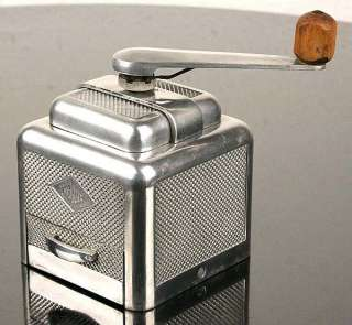Very rare french art deco machine age designed coffee grinder. A