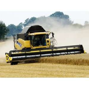 Yellow New Holland Combine Harvester Harvesting Wheat Field, UK